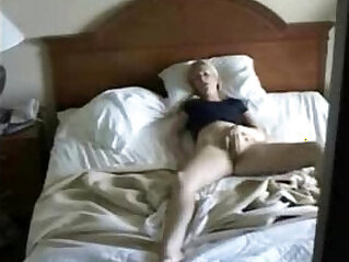 My mum masturbating caught by hidden cam on the closet