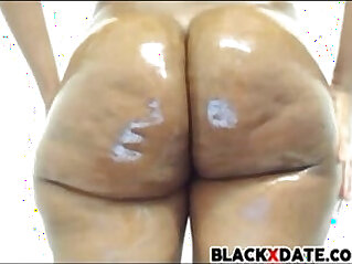 Round and brown ebony booty oiled and ready