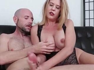 Horny brunette milf jerks off a huge dick