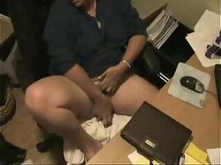 My mum masturbating at her desk caught by hidden cam