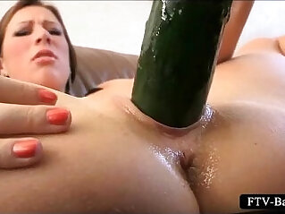 Excited big titted girl strips and masturbates with cucumber