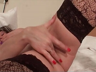 Turned on mature slut sucks dildo and rubs her muffin